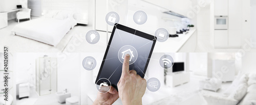 Fotografija  smart home automation hand touch digital tablet screen with symbols on indoors r