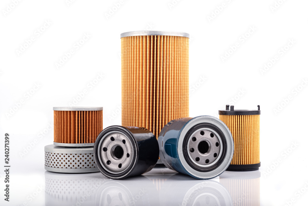 Fototapeta Auto parts accessories :  Oil , fuel or air filter for engine car  isolated on white background.
