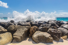 A Beach In Barbados With Waves Crashing Over Rocks