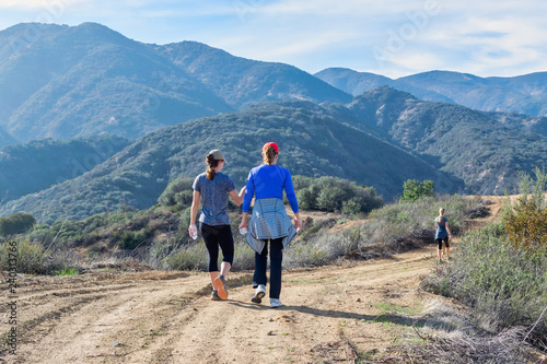 Mother and daughter hiking in the mountains