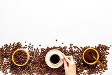 Coffee Concept. Roasted Beans, Ground Coffee, Cup Of Espresso On White Background Top View Copy Space