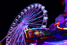 Abstract Of Colorful Ferris Wheel At Night At The County Fair