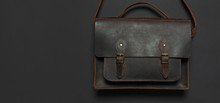 Fashionable Concept. Brown Leather Men's Bag On Black Background Top View Flat Lay With Copy Space. Briefcase For Work, Accessories Businessman, Stylish Men's Clothes, Business Background.