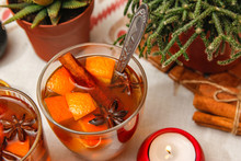 Romantic Composition With Two Cups Of Tea With Orange, Anise And Cinnamon. On Table Also Candles, Cactus, Dried Orange And Cinnamon Sticks.