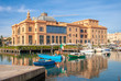 Little Harbor with wooden boats and theater in the background, Bari, Puglia, Italy