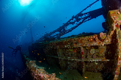 Fotobehang Schipbreuk scuba diver diving Ship Wreck in maldives indian ocean