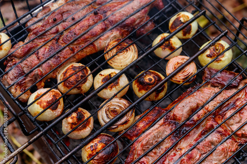 Pork meat cooking on the grill