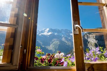 Alps in summer morning. Gimmelwald, Lauterbrunnen, Switzerland, Alps mountain landscape through the window. Europe Swiss.