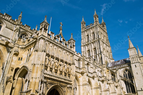 Looking up at the tower of historic Gloucester cathedral in spring sunshine, Glo Fototapeta