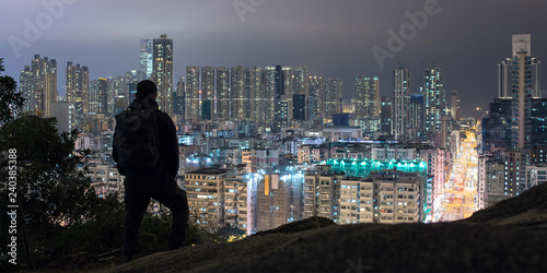 Man enjoying night view of Hong Kong from Garden Hill 香港の夜景を嘉頓山から観る男性