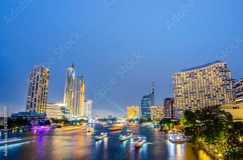 Cityscape of boat light trails on Chao Phraya River night scene in Bangkok, Thailand Wallpaper Mural