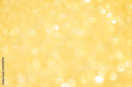 Fototapeta Defocused gold glitter background. Gold abstract bokeh background. Christmas abstract background obraz na płótnie