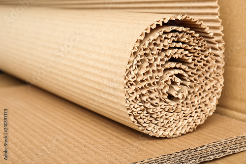 Stampa su Tela Roll of brown corrugated cardboard, closeup. Recyclable material