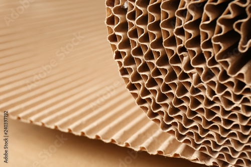 Closeup view of roll of brown corrugated cardboard, space for text Fotobehang