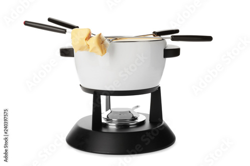 Pot of delicious cheese fondue and forks with bread on white background