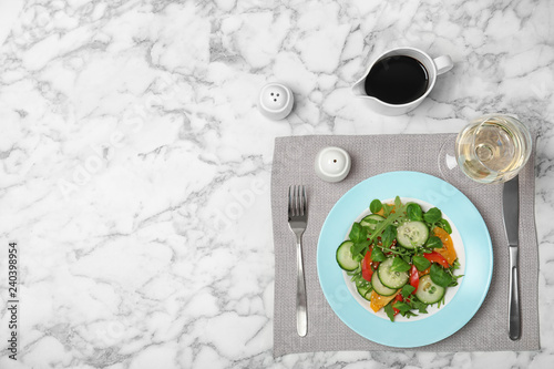 Vegetable salad and balsamic vinegar served on marble table, top view. Space for text