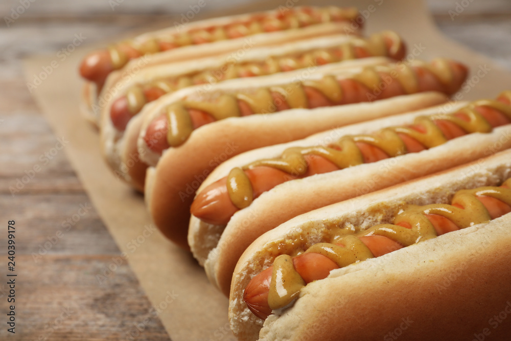 Fototapety, obrazy: Hot dogs with mustard on wooden table, closeup