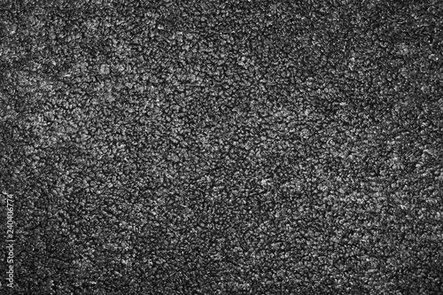 Photo Dark gray or black faux astrakhan fur texture background