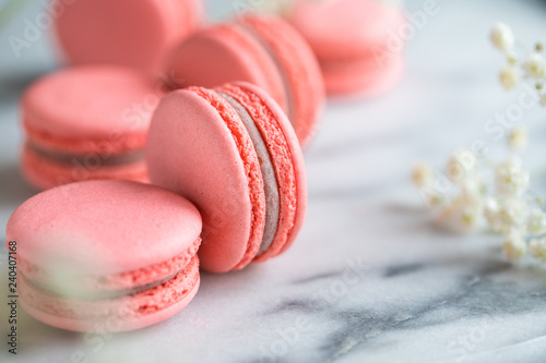 Fotobehang Macarons Coral cakes macarons or macaroons on white marble.