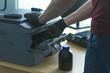 Laser cartridge toner refill or repair concept. Office equipment maintenance concept.