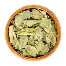 Dried Curry Leaves In Wooden Bowl. Whole Green Leaves Of The Curry Tree, Murraya Koenigii, A Spice, Often Used In Indian Curries. Isolated Macro Food Photo, Closeup, From Above, On White Background.