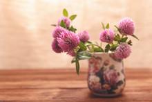 Clover Flowers On Wooden Backg...