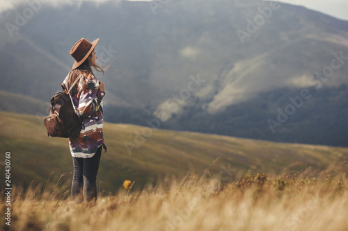 Stylish hipster girl in hat walking on top of mountains фототапет