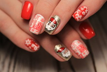 Beautiful Woman's Nails With Beautiful Christmas Manicure