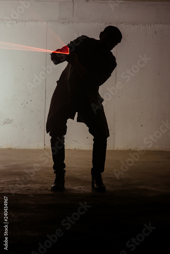 Photo  Silhouette of a man with laser