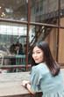 Portrait of beautiful asian women sitting on wood table in art coffee shop