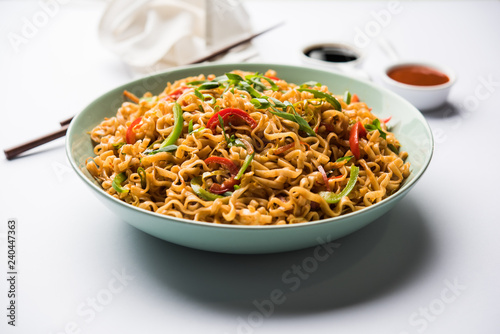 Schezwan veg noodles is a spicy and tasty stir fried flat Hakka noodles with sauce and veggies Canvas Print