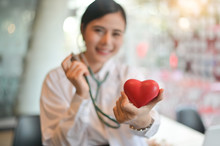 Female Doctor Holding A Heart Model And Stethoscope Medicine And Health Care Concept - Image.