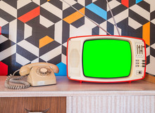 Retro Television Mock Up With Vintage Telephone And Wallpaper In The Background. Template Interior Decoration With Ceramic Decoration From The 70s