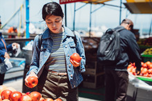 Young Girl In Farmer Market In...