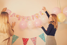 Friends Preparing Baby Shower For Pregnant Woman.