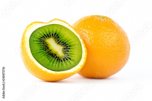 Creative photo manipulation of sliced orange with green kiwi inside isolated on white background
