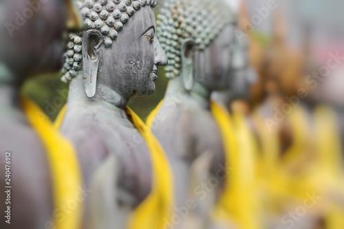 Keuken foto achterwand Historisch mon. Buddha Statues in Seema Malaka Temple, Colombo, Sri Lanka. Selective Focus.