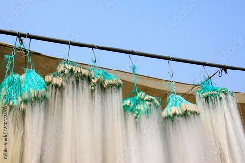 Fotografía  suspension of fishing nets in the market