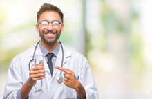 Adult Hispanic Doctor Man Drinking Glass Of Water Over Isolated Background Very Happy Pointing With Hand And Finger