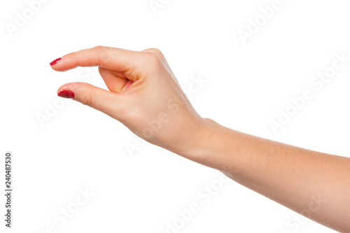 Valokuvatapetti Female manicured hand measuring invisible items, woman's palm making gesture