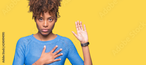 Fototapeta Beautiful young african american woman over isolated background Swearing with ha