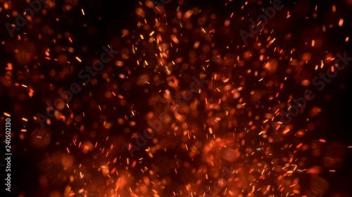Fotografía  Burning red hot sparks fly from large fire in the night sky
