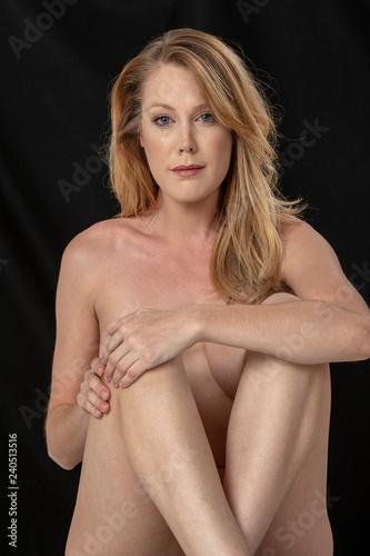 Fotografie, Obraz  Emotional Nude Figure Model Posing Against A Black Background