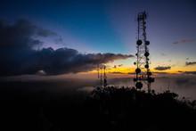 Telecommunication Transmitting Tower At Dawn On Top