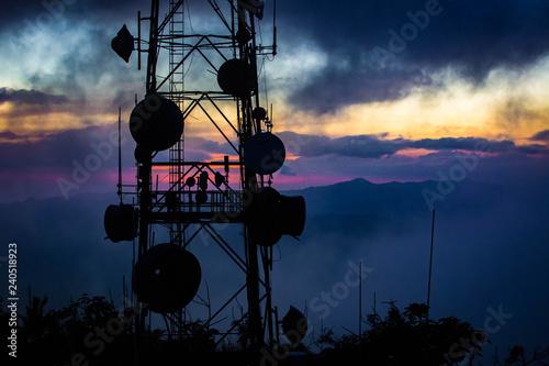 Valokuva  Telecommunication transmitting tower at dawn on top