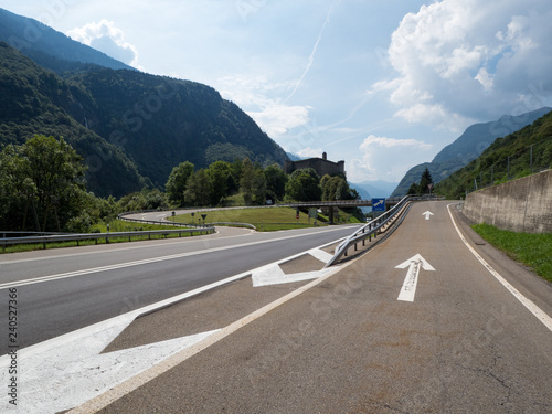 Curved asphalt road with perfect asphalt on countryside on sunny day, Switzerland, august 2018 Canvas Print