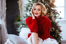 Smiling Woman In Red Sweater O...