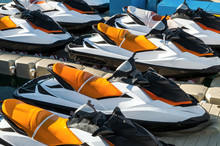 Colored Jet Skis Parked On Floating Watercraft Pontoon