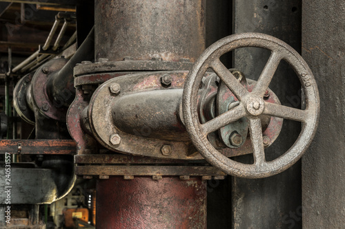 Aluminium Prints Old abandoned buildings Cooling water pipe in a historic industrial facility.