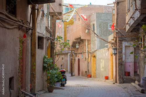 Photo Stands Narrow alley Sunny Kashgar alleyway in the old town, Kashgar, Xinjiang, China
